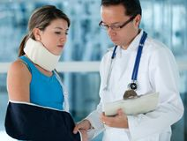Injured woman with a doctor Stock Photo
