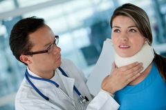 Injured woman with a doctor Stock Photos
