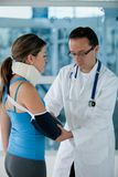 Injured woman with a doctor Stock Photography