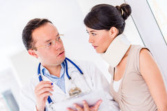 Injured woman at the doctor Stock Photo