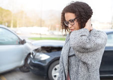 Injured woman feeling bad after having car crash Royalty Free Stock Photography