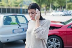 Injured woman feeling neck pain after car crash stock photography