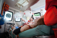 Injured woman needs oxygen in ambulance Royalty Free Stock Images