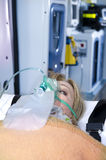 Injured Woman With Oxygen Mask Royalty Free Stock Photography