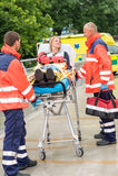 Injured woman talking with paramedics emergency. Patient talking with paramedics after accident aid emergency arm injury royalty free stock photography