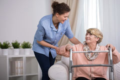 Injured woman with walker Royalty Free Stock Images