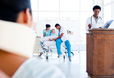 Injured woman on wheelchair and medical team Royalty Free Stock Photography