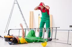 Injured worker and his workmate. The injured worker and his workmate stock photos