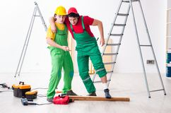 Injured worker and his workmate. The injured worker and his workmate stock image