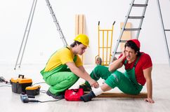 Injured worker and his workmate. The injured worker and his workmate stock photography