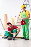 Injured worker and his workmate. The injured worker and his workmate royalty free stock images