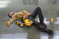 Injured Worker Laying on Floor Stock Images
