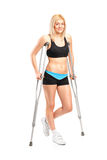 Injured young fenmale on crutches Royalty Free Stock Photos