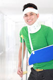 Injured young man keep smile Stock Images