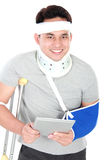 Injured young man play gadget Royalty Free Stock Photography