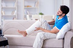 The injured young man recovering at home Stock Photography