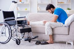 The injured young man recovering at home Royalty Free Stock Photo