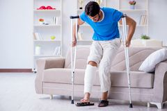 The injured young man recovering at home Royalty Free Stock Image