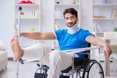 The injured young man recovering at home Royalty Free Stock Images