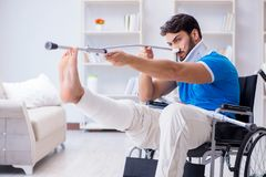 The injured young man recovering at home Stock Images