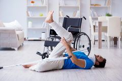 The injured young man recovering at home Stock Photos