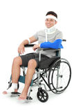 Injured young man sit in wheelchair Royalty Free Stock Photography