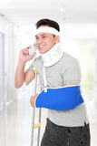 Injured young man talking on the phone Royalty Free Stock Photo