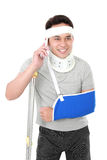 Injured young man talking on the phone Royalty Free Stock Image