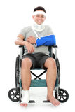 Injured young man in wheelchair Royalty Free Stock Photos