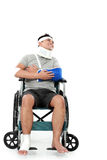 Injured young man in wheelchair Stock Image