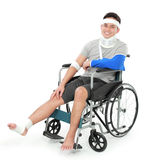 Injured young man in wheelchair Stock Images