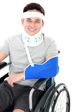 Injured young man in wheelchair Royalty Free Stock Photography