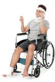 Injured young man in wheelchair talking on the phone Stock Photo