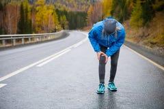 Injuries - sports running knee injury on woman. Royalty Free Stock Image