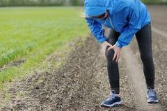 Injuries - sports running knee injury on woman. royalty free stock photos