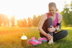 Injuries - sports running knee injury on woman. Stock Images