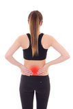 Injury concept - young sporty woman with pain in her back isolat Royalty Free Stock Image