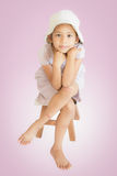 Injury cute girl sitting on wooden seat Stock Photos