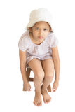 Injury cute girl sitting on wooden seat Royalty Free Stock Photo