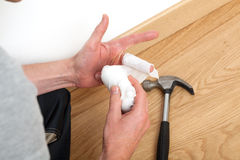 Injury during domestic work Stock Photos