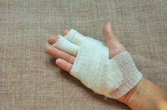 Injury hand with bandage Royalty Free Stock Images