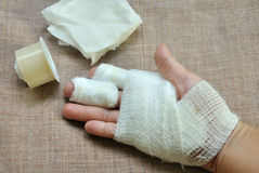 Injury hand with bandage. And first aid tape royalty free stock image