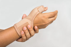 Injury hand with wrist supporter Stock Image