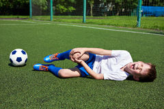 Injury of knee in boy football. Injury of the knee in the boy football soccer player stock photography