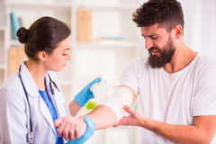 Injury man in doctor stock photos