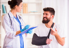 Injury man in doctor stock images
