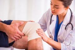 Injury man in doctor Stock Image
