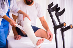 Injury man in doctor Stock Photo