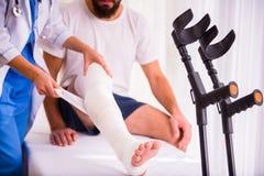 Injury man in doctor stock photo