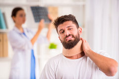 Injury man in doctor Stock Photography
